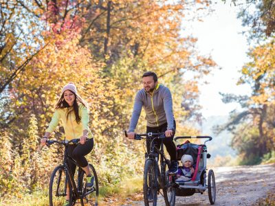 Young family cycling with bike trailer